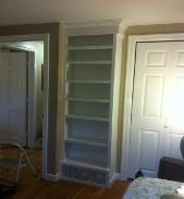 Office Bookcase Built Over Air Exchange